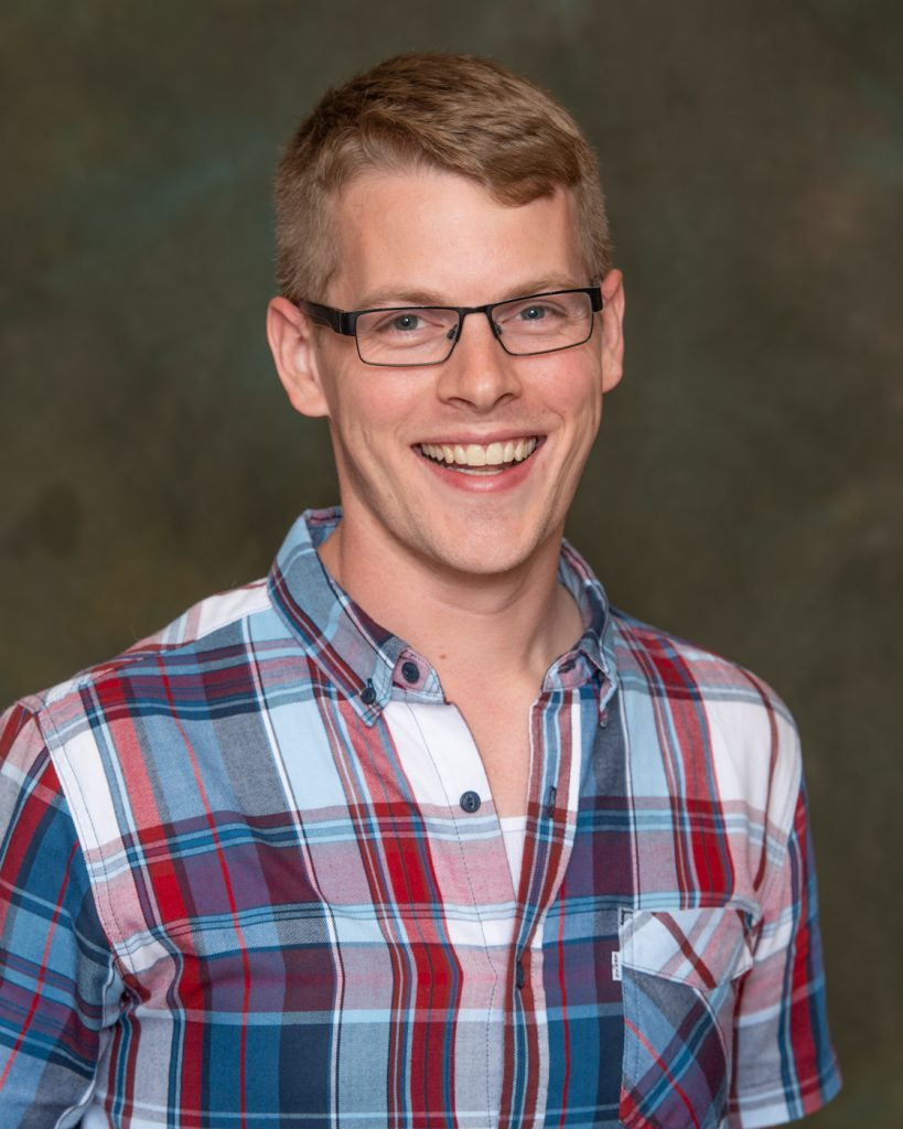 Andy Petersen in a plaid shirt.