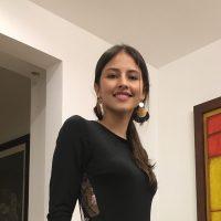 woman in black shirt and big earrings
