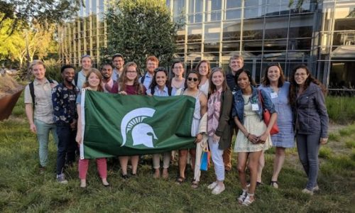 group of students with spartan flag